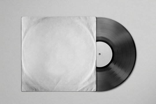 Vinyl record mockup in a crumpled old paper package on a textured background