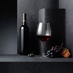 Red wine and blue grapes on a black stone table.