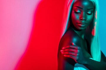 Photo of young gorgeous stunning lovely afro woman touching shoulder body care isolated on colorful glowing background