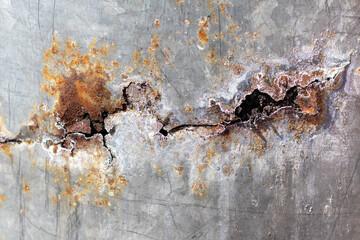 Fototapeta Zardzewiała blacha ocynkowana z dziurą.