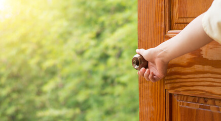 Women hand open door knob or opening the door, grand opening, Close up hand open door. Wall mural