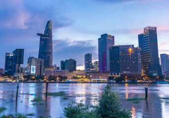 Bitexco Financial Tower building, buildings, roads and Saigon river in Ho Chi Minh city - This city is a popular tourist destination of Vietnam. Business and landscape concept.
