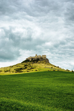 spis, slovakia - 29 APR 2019: castle ruins on the hill. grassy meadow in the foreground. popular travel destination on a cloudy day