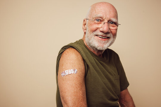 Portrait of senior man after getting vaccine