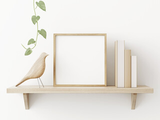 Obraz Small square wooden frame mockup in scandi style interior with trailing green plant, bird, pile of books and shelf on empty neutral white wall background. 3d rendering, illustration - fototapety do salonu