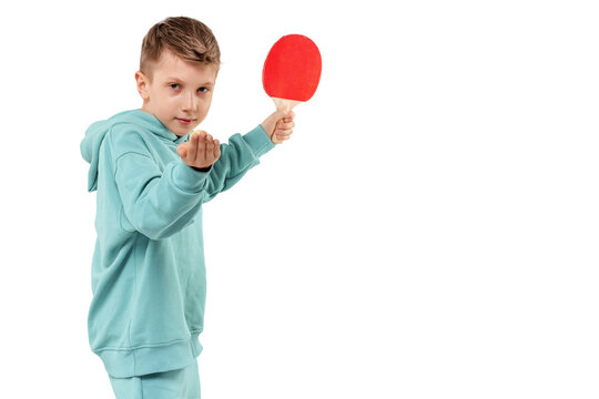 Handsome boy in burgundy suit plays ping pong isolated on white background. Sports concept, masterclass, table tennis. Isolate, copy space.