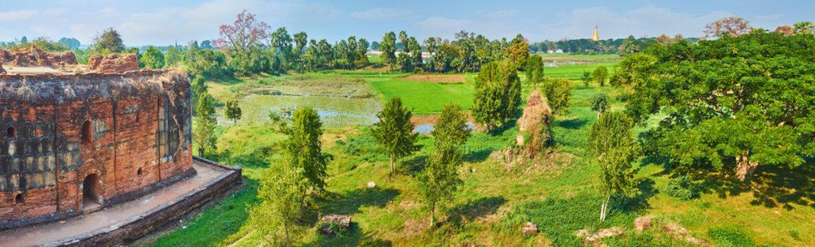 Panorama of Wingaba Monastery and green meadow, Ava, Myanmar