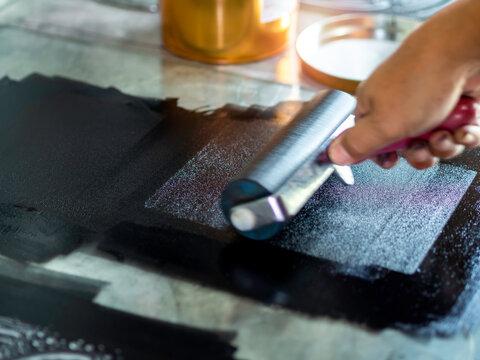 Printmaking tool in art studio.