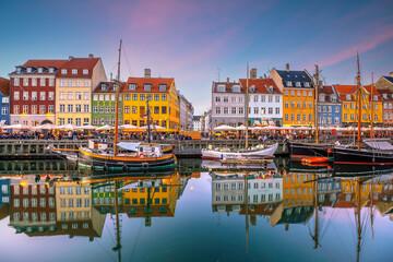 Fototapeta Copenhagen city skyline in Denmark at famous old Nyhavn port obraz