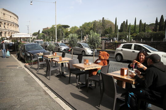 Bars and restaurants reopen as Italy eases COVID-19 restrictions, in Rome