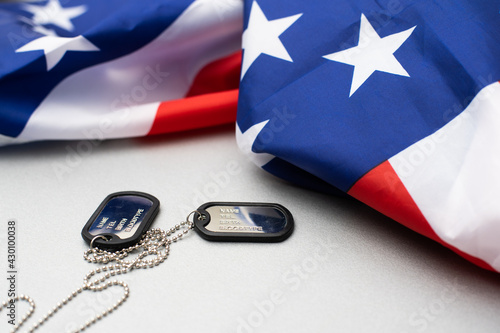 Army tokens on American national flag background