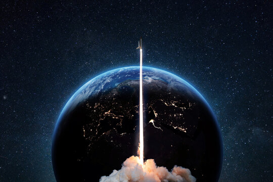 Rocket successful takeoff into deep starry space against the backdrop of the blue earth planet. Spaceship at launch from Earth, concept