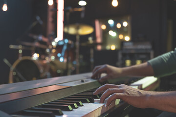 Hands of a musician playing the keys close up.
