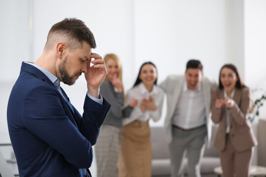 Coworkers bullying their colleague in office, space for text