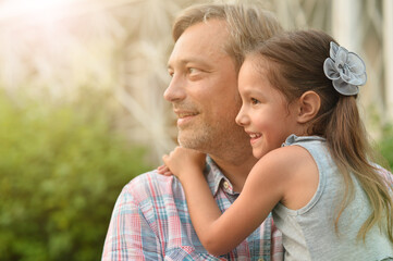 Fototapeta happy father and  daughter hugging outdoors obraz