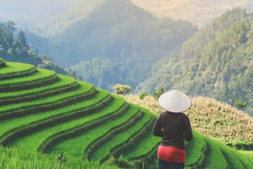 Girl enjoying rice terrace viewpoin in Mu cang chai, Vietnam