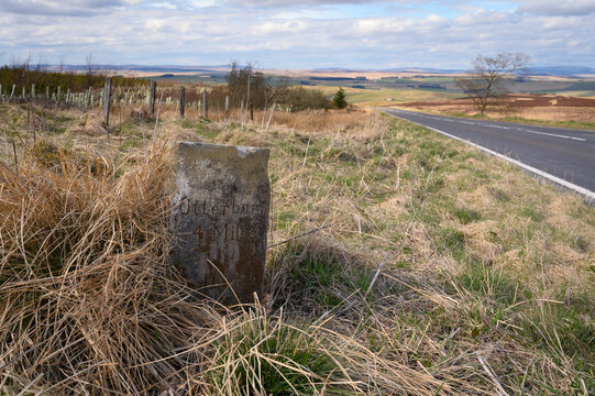 Old Milestone near Otterburn on A696, where there are several ancient marker posts on the rural A696 road in Northumberland
