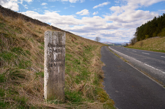 Milestone north near Otterburn on A696, where there are several ancient marker posts on the rural A696 road in Northumberland