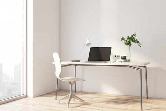 Sunny stylish work place in home office area with light wooden chair and table and city view from big window