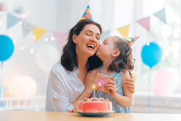 Fototapeta Mother and daughter are celebrating birthday.