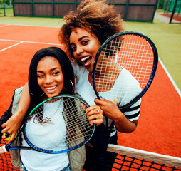 Fototapeta young pretty girlfriends hanging on tennis court, fashion stylish dressed swag, best friends happy smiling together