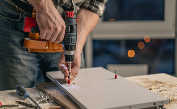 Man working during process of furniture manufacturing