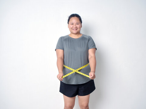 Overweight woman with measuring tape