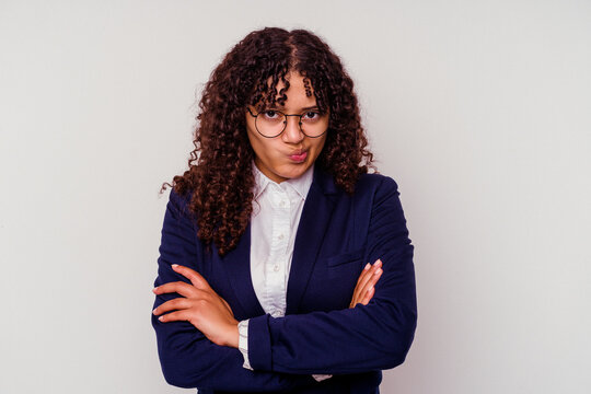 Young business mixed race woman isolated on white background frowning face in displeasure, keeps arms folded.