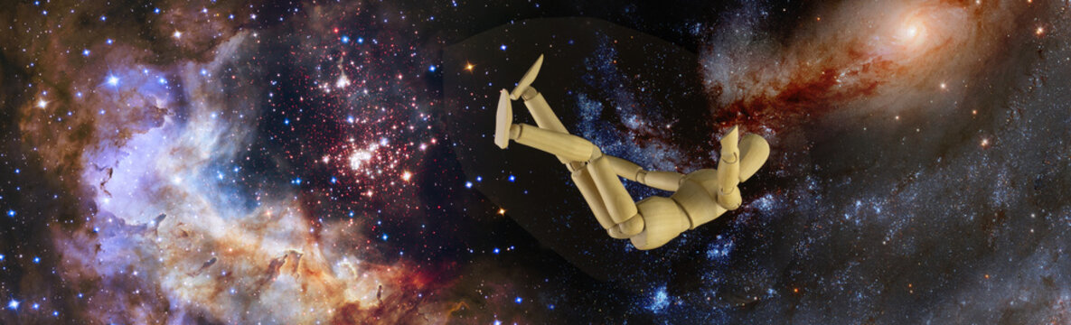 Falling manikin and DNA on the background of the starry sky. Elements of this image furnished by NASA. 3d-image.