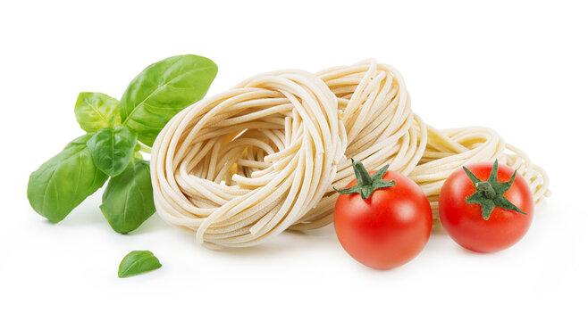 Pici, bronze-drawn durum wheat pasta, Tuscan handmade spaghetti, isolated on white background with basil, peppercorns and cherry tomatoes.