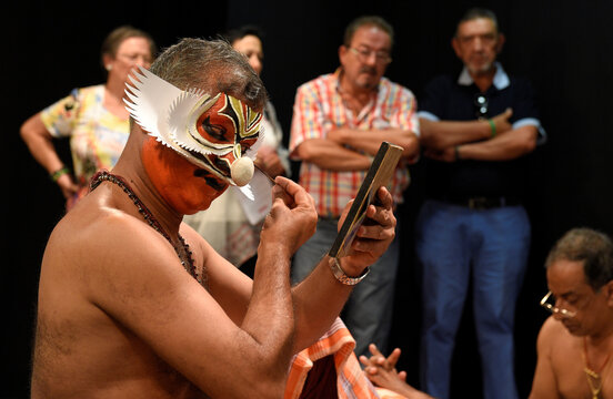 """The public watch as members of the Indian company Margi Kathakali theatre apply makeup before their """"Kijote Kathakali"""" performance, a Kathakali recital based on the Spanish classic """"Don Quixote"""", at the Niemeyer Center in Aviles"""