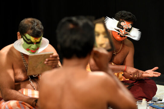"""Members of the Indian company Margi Kathakali theatre apply makeup before their """"Kijote Kathakali"""" performance a Kathakali recital based on the Spanish classic """"Don Quixote"""" at the Niemeyer Center in Aviles"""