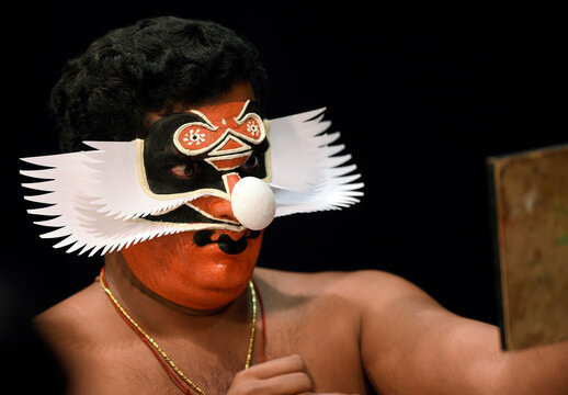 """Member of the Indian company Margi Kathakali theatre applies makeup before their """"Kijote Kathakali"""" performance, a Kathakali recital based on the Spanish classic """"Don Quixote"""", at the Niemeyer Center in Aviles"""