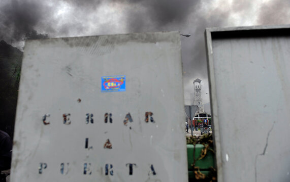 """Locker doors used by miners as shields, with the words """"close the door"""", are seen as part of barricade in front of the main gate of the """"Pozo Santiago"""" mine in Caborana"""