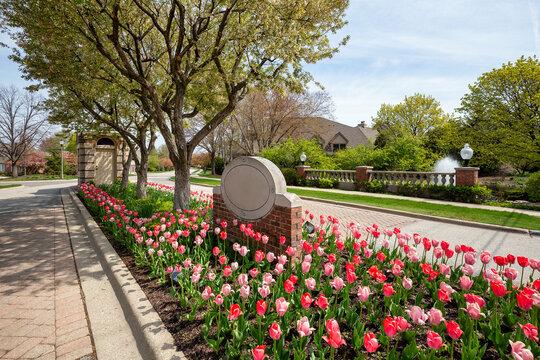Landscaped housing development entrance with flowers