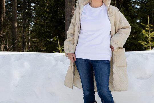 White sweatshirt mockup of a girl in winter coat, model mockup