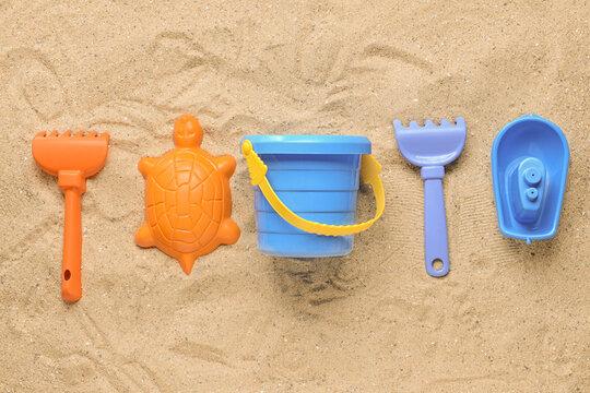 Set of beach toys for children on sand
