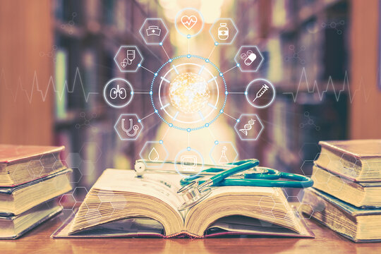 Medical school education with telemedicine and telehealth science study and lab research concept with global healthcare educational icons on old book and stethoscope in learning class room or library