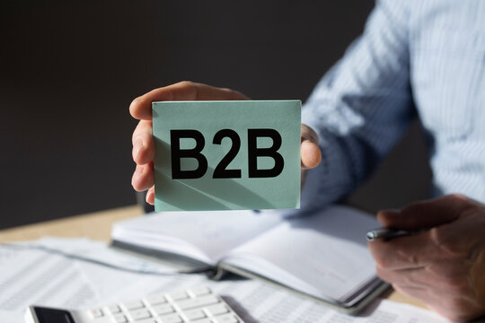B2B, btob acronym, word on paper in businessman hand. Business concept.