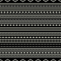 Fototapeta Ethnic and monochrome pattern. Black background and primitive ethnic forms.