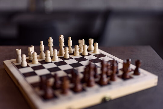 Close-up image of chessboard prepared for a new game.
