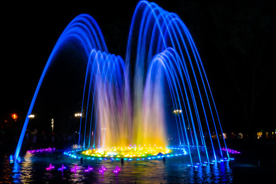 Colored water fountain at night