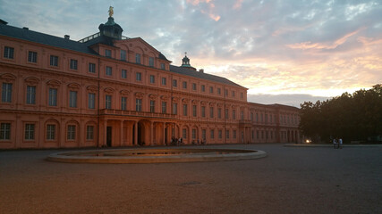 Obraz Rastatt, Germany - June 26, 2020  The Rastatt castle is also known as Residenzschloss Rastatt  in the Baden-Wurttemberg: it is a Baroque schloss. Shot at the sunset in a cloudy summer day. - fototapety do salonu