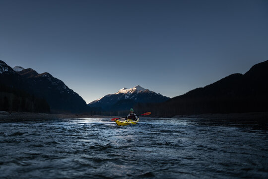 Canada, British Columbia, Woman kayaking in Squamish River