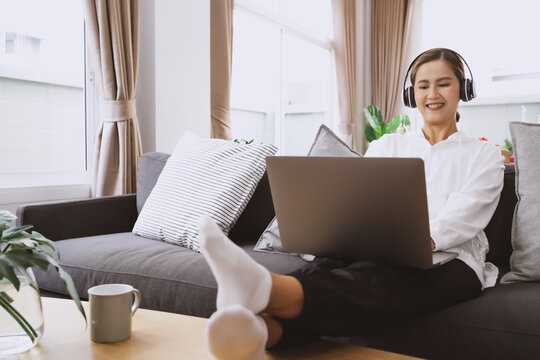 Young asian student watching lesson online and studying from home. online education concept.