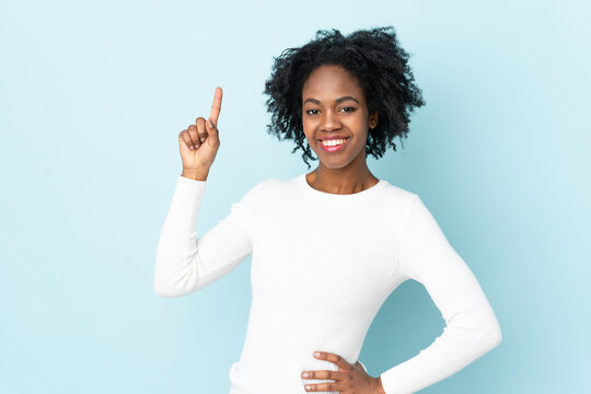 Young African American woman isolated on blue background showing and lifting a finger in sign of the best