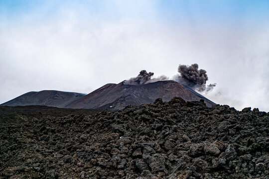 Mount Etna spits ash and smoke