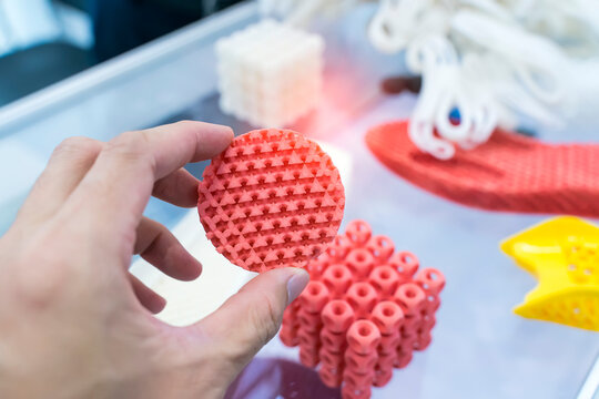 hand with Object printed on 3d printer close-up.
