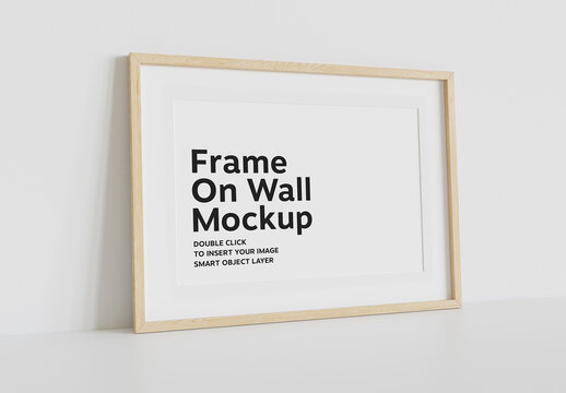 Wood Frame Mockup Leaning on White Wall