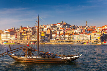 Port wine boats at the waterfront with the old town on the Douro River in Ribeira in the city centre of Porto in Porugal, Europe. Portugal, Porto